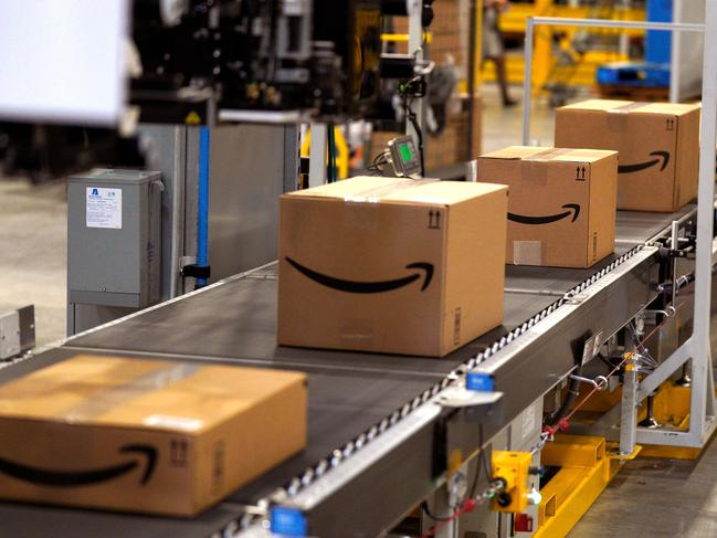 Amazon is offering employees $10,000 to quit their jobs and become independent package delivery entrepreneurs for the online retail colossus. Picture: Getty Images/AFP