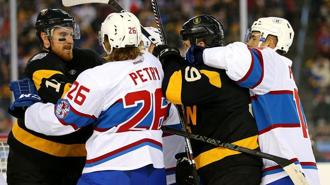 Jimmy Hayes #11 of the Boston Bruins and Jeff Petry #26 of the Montreal Canadiens fight.