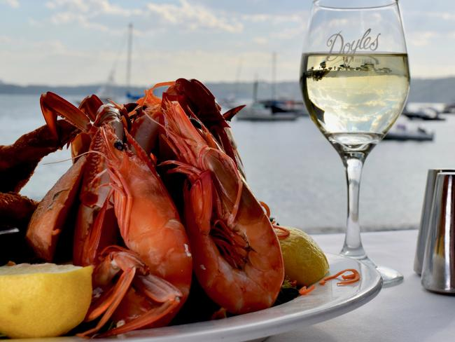 The seafood platter and glass of wine with a stunning view at Doyles. Picture: Jenifer Jagielski. Picture: Jenifer Jagielski