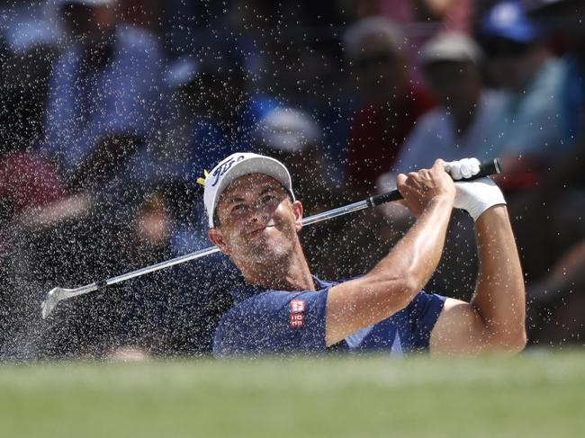 Adam Scott blasts out of a bunker during the second round. Picture: AP