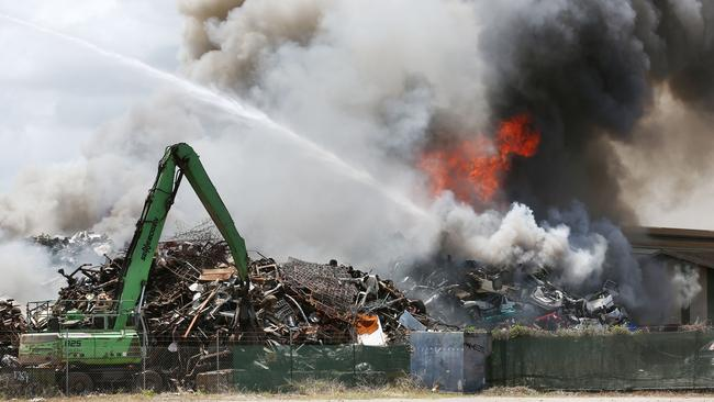 A large explosion caused a fire that burnt out of control at Sims metal scrap yard on Comport Street, Portsmith. Fire fighters used a large crane hose to fight the fire. Picture: BRENDAN RADKE.
