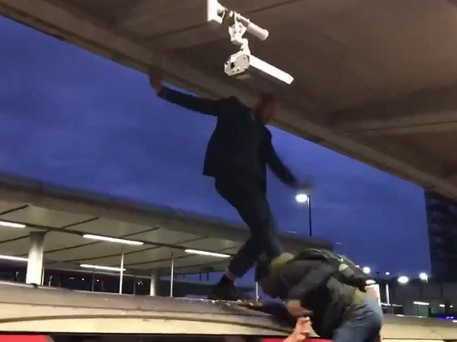 Commuters dragged the protester off the roof of the train. Picture: Supplied