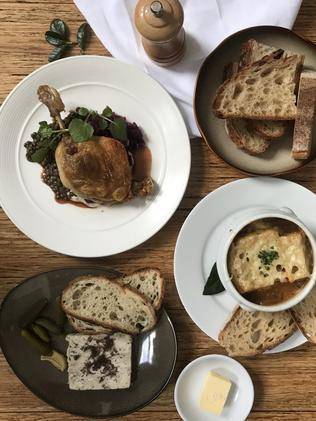 French onion soup and confit duck leg with parsnip puree at St Claude's. Picture: Jenifer Jagielski