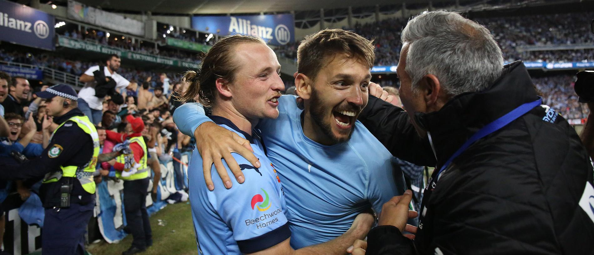 Sydney's Rhyan Grant and Milos Ninkovic (centre) celebrate after winning the A-League Grand Final between Sydney FC and Melbourne Victory at Allianz Stadium in Sydney, Sunday, May 7, 2017. (AAP Image/David Moir) NO ARCHIVING, EDITORIAL USE ONLY