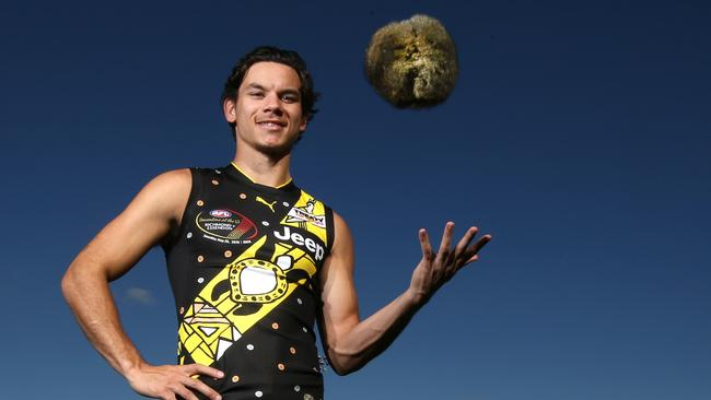 Richmond dual premiership player Daniel Rioli with the Indigenous Round Dreamtime jumper he designed with his parents in the Tiwi Islands. Inside talk in the AFL is that any Darwin-based AFL team would have a core of NT players. Picture: David Caird