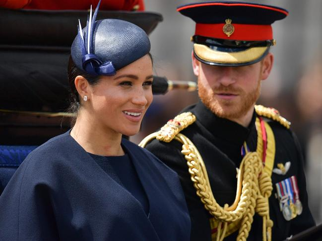Meghan and Harry having a royal protocol debriefing after Trooping The Colour. Picture: AFP