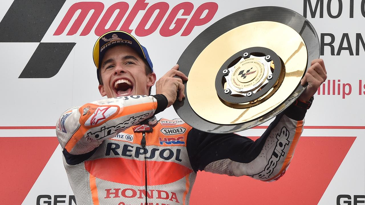 Marc Marquez holds up the trophy after winning the Australian Grand Prix. Picture: Peter Parks