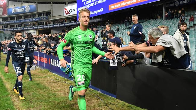 Melbourne Victory Lawrence Thomas celebrates after the final whistle after winning the A-League Semi-Final