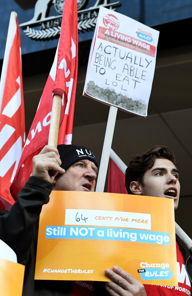 ACTU members rally outside the offices of the Fair Work Commission, saying workers are still living in poverty. Picture: AAP Image/Joe Castro