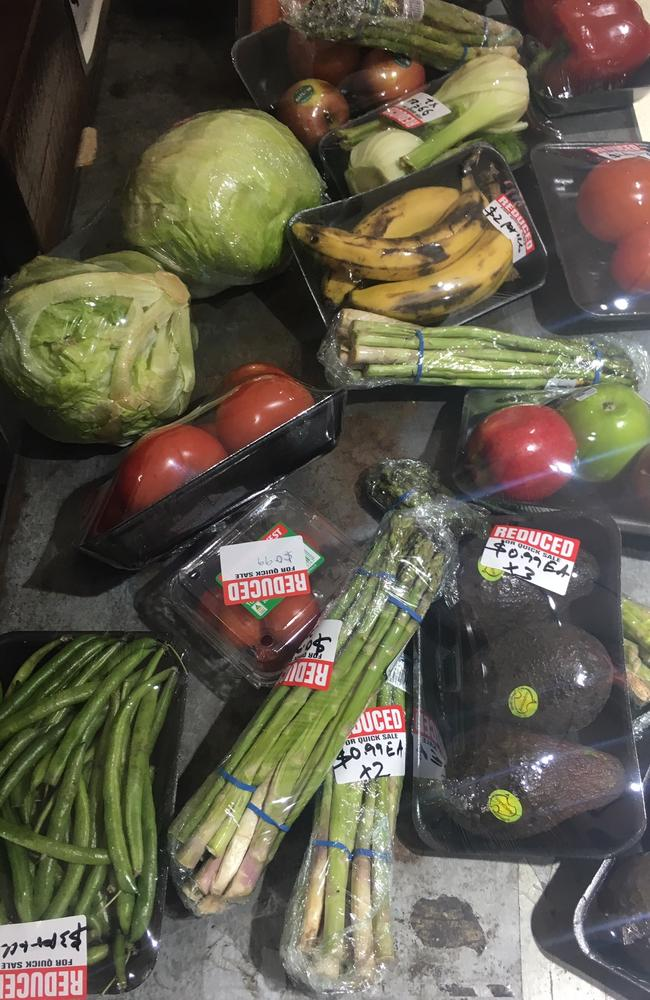 The reduced fruit and vegetables at IGA are similar, with everything from lettuce heads to bananas and avocados sealed in plastic.