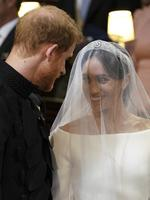 Britain's Prince Harry, Duke of Sussex (L) and US actress Meghan Markle (R) stand together at the altar in St George's Chapel, Windsor Castle, in Windsor, on May 19, 2018 during their wedding ceremony. Credit: AFP PHOTO / POOL / Dominic Lipinski