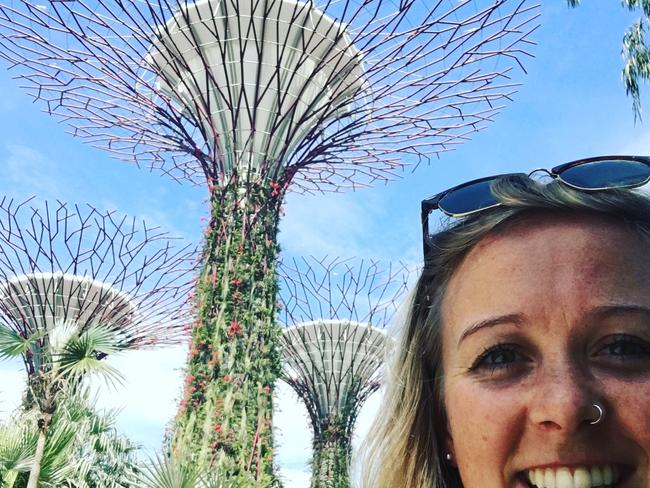 Annabel, pictured here in Singapore, has travelled all over the world assisting Australian holiday-makers.