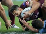 Billy Slater of the Maroons attempts a try during Game 3 of the 2018 State of Origin series between the NSW Blues and the Queensland Maroons at Suncorp Stadium in Brisbane, Wednesday, July 11, 2018. (AAP Image/Jono Searle)