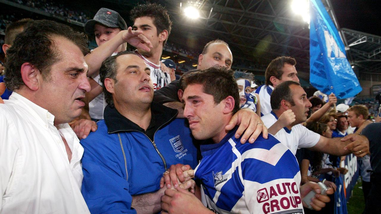 An emotional Braith Anasta with relatives after the Bulldogs' grand final win