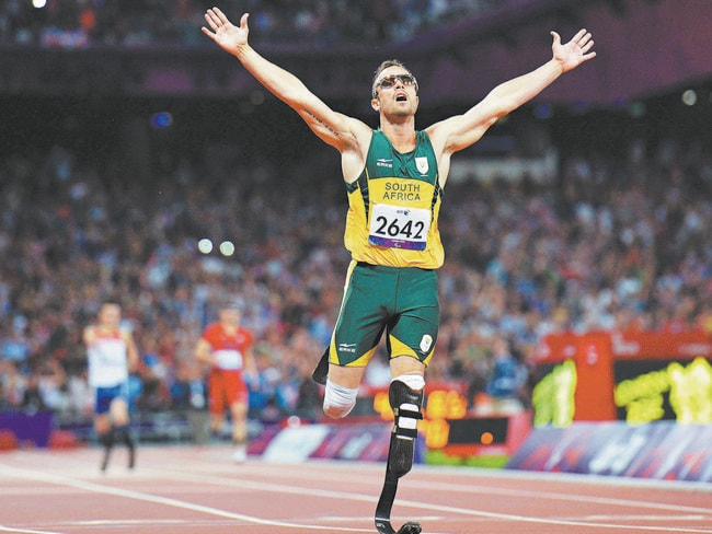 Fall from grace ... Oscar Pistorius crosses the line to win gold at the London 2012 Paralympic Games. Picture: AFP