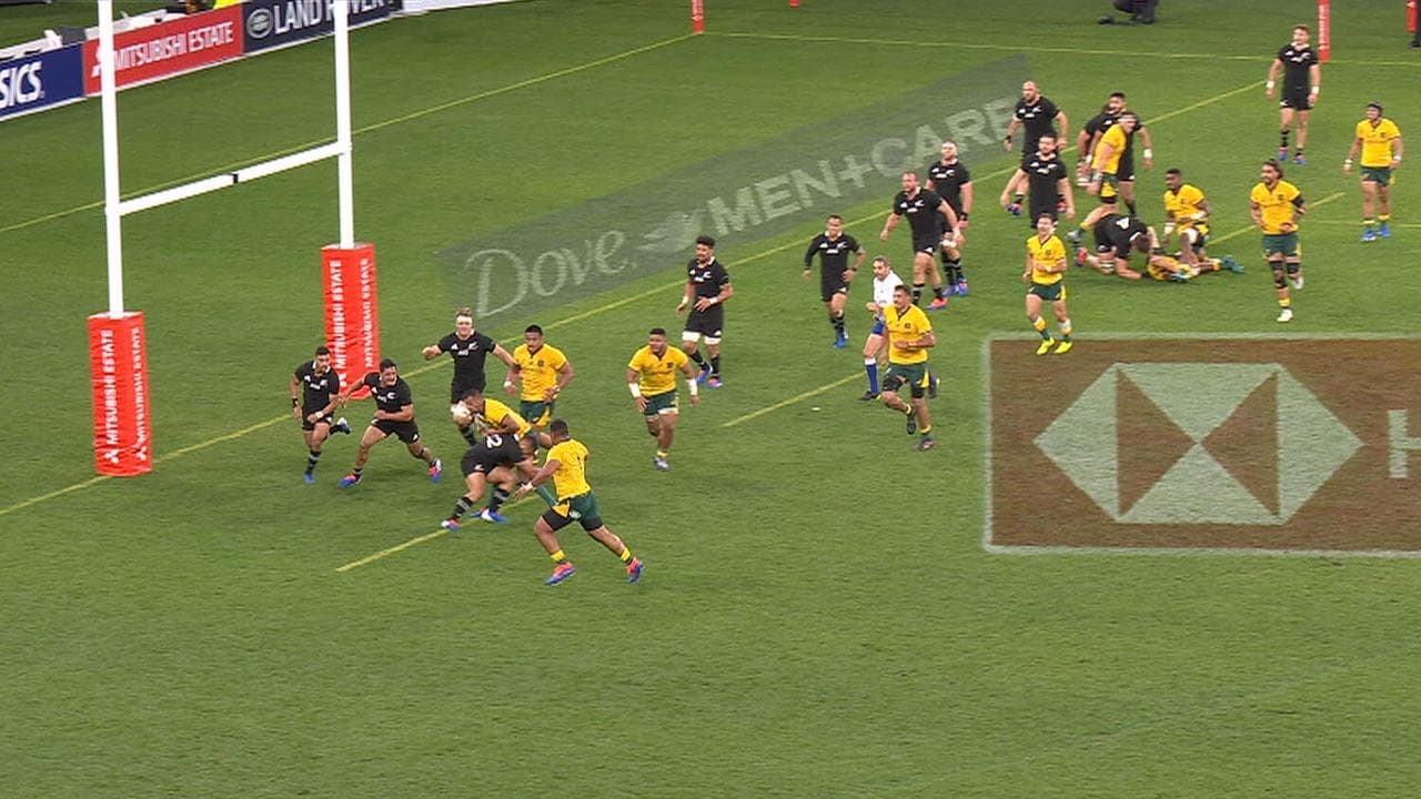 Michael Hooper (top right) sprawled across the ground after being hit hard by All Blacks lock Scott Barrett.