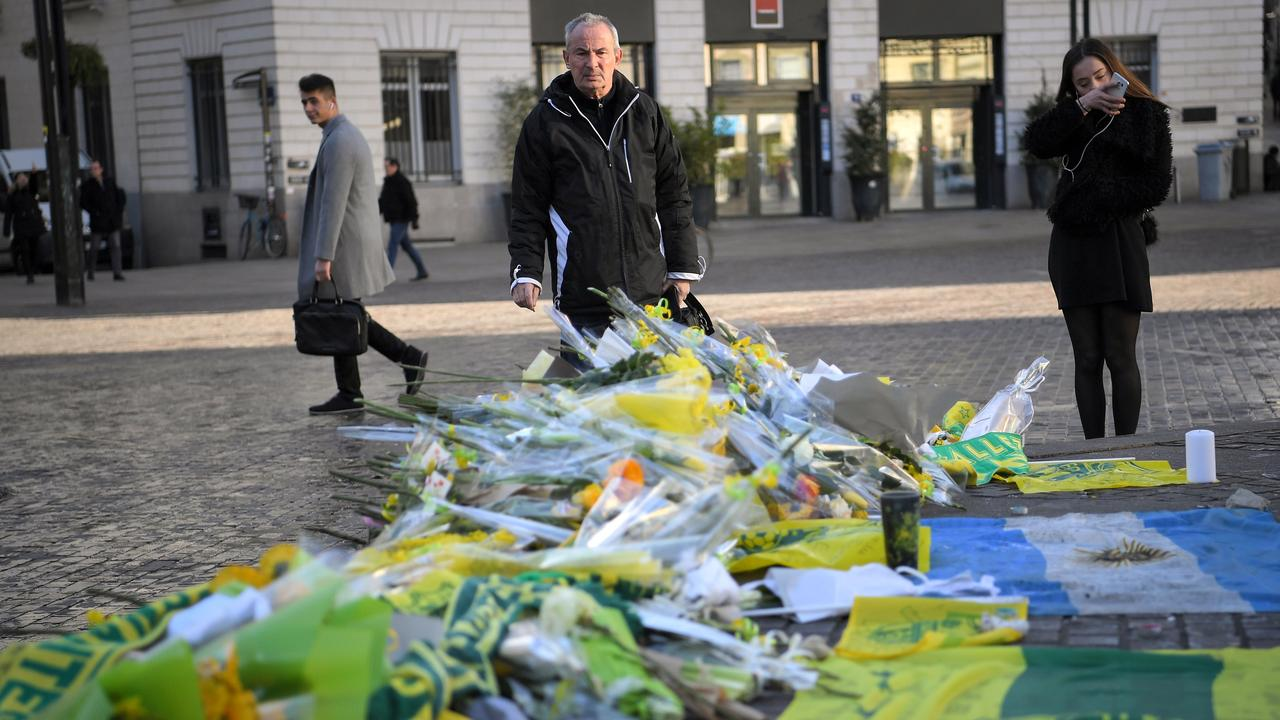 FC Nantes football club supporters looks at flowers and candles placed in the main square of the city of Nantes.