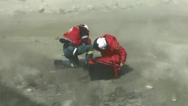 Rescuers arrive on White Island after the volcano eruption. Picture: Auckland Rescue Helicopter Trust