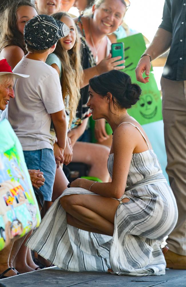 Here's another look at the daring dress as Meghan met locals . Picture: Chris Jackson/Getty Images