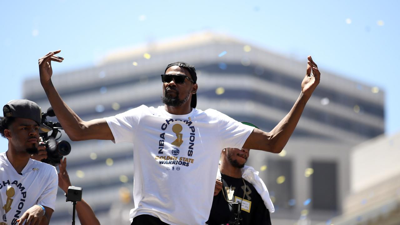 Kevin Durant of the Golden State Warriors gestures to the crowd during the Golden State Warriors Victory Parade.