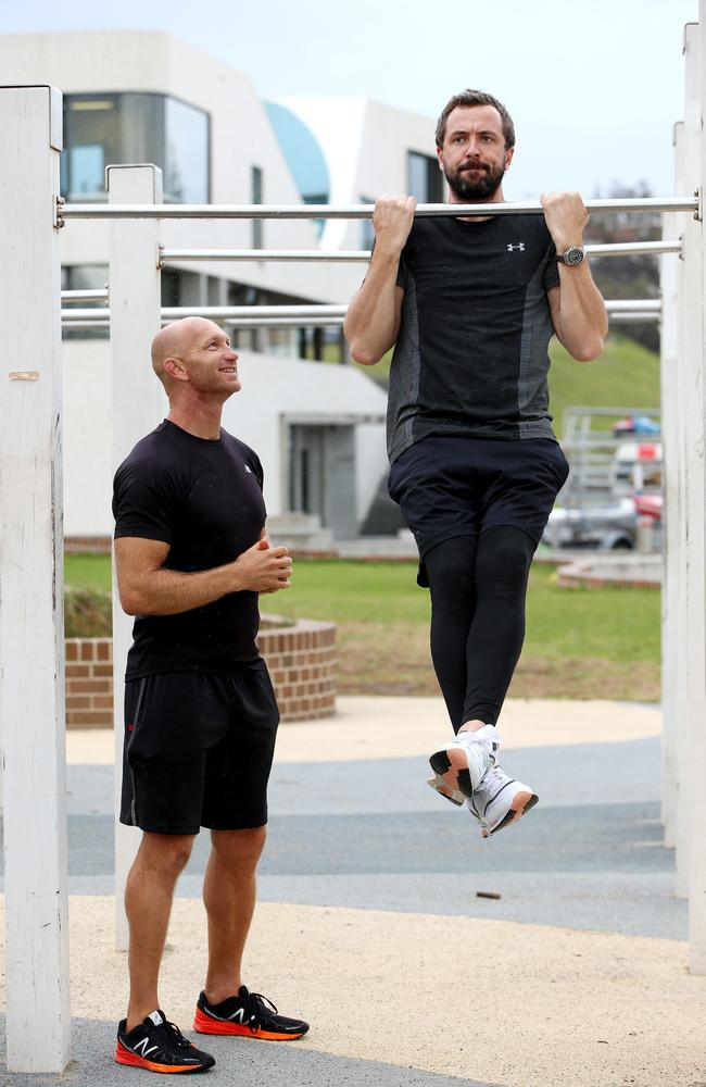 Adam MacDougall puts Darren McMullen through his paces. Picture: Damian Shaw