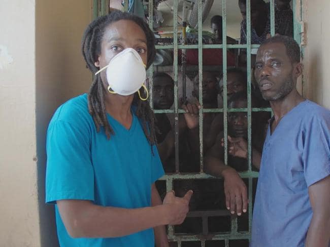 Seyi Rhodes points to a cell when dozens of men are crammed inside, some of whom are ill or in bad health. Picture: Seyi Rhodes/Dateline