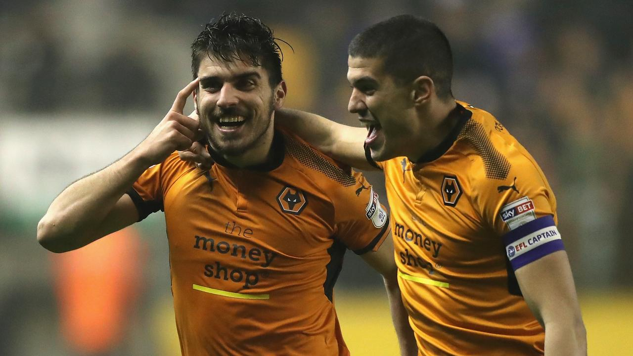 Ruben Neves (L) of Wolverhampton Wanderers celebrates with team mate Conor Coady