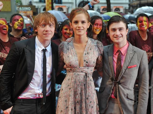 Rupert Grint (right) found the press tours hard to handle. Picture: AFP/Leon Neal