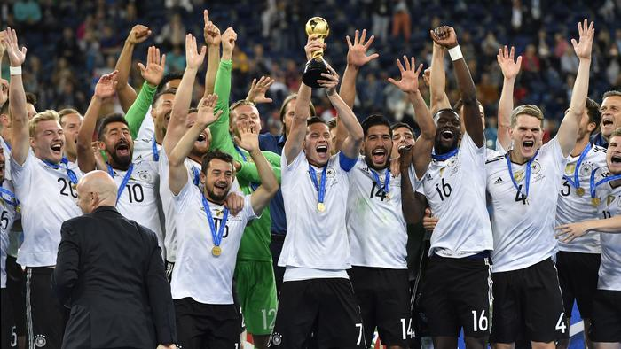 Germany's Julian Draxler, center, lifts the trophy after Germany won 1-0 in the Confederations Cup final soccer match between Chile and Germany, at the St.Petersburg Stadium, Russia, Sunday July 2, 2017. (AP Photo/Martin Meissner)