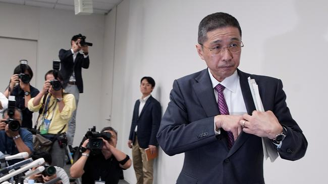 Nissan's Hiroto Saikawa walks out after speaking to media about Carlos Ghosn. Picture: AP