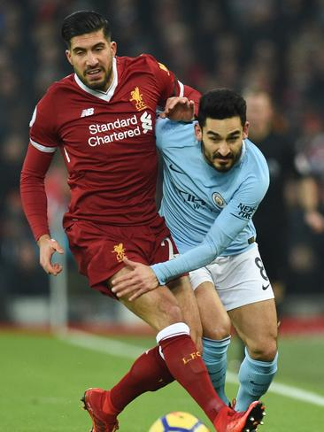 Liverpool's German midfielder Emre Can (L) tangles with Manchester City's Ilkay Gundogan (R)