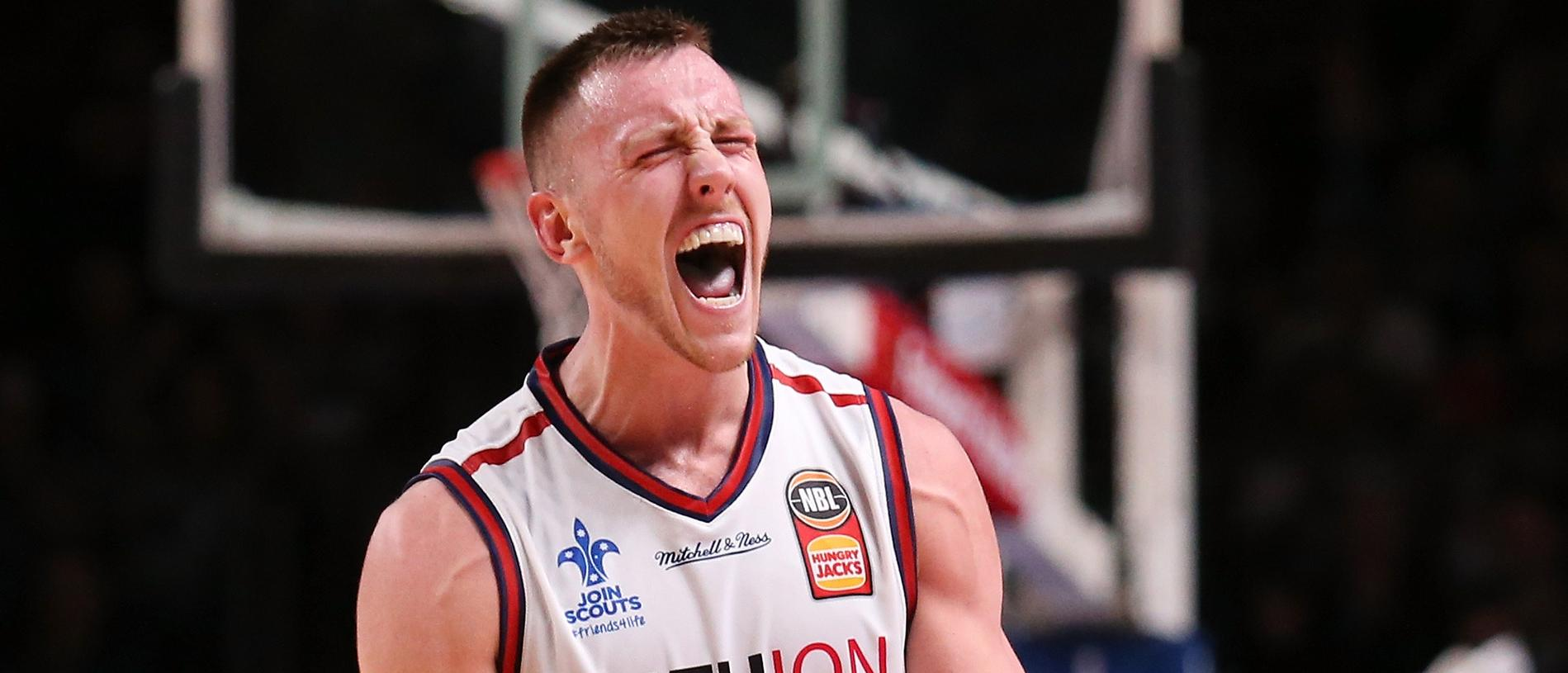 Mitch Creek of the Adelaide 36ers celebrates their win during the Round 8 NBL match between Adelaide 36ers and Brisbane Bullets at Titanium Security Arena, Adelaide, Friday, December 1, 2017. (AAP Image/ James Elsby) NO ARCHIVING, EDITORIAL USE ONLY