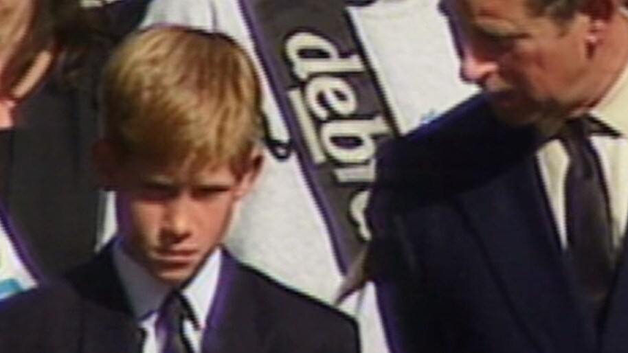 Footage plays in the trailer of a young Prince Harry at his mother Diana's funeral.
