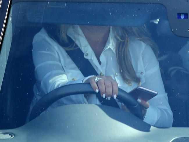 A driver on her phone behind the wheel in North Sydney. Picture: John Grainger