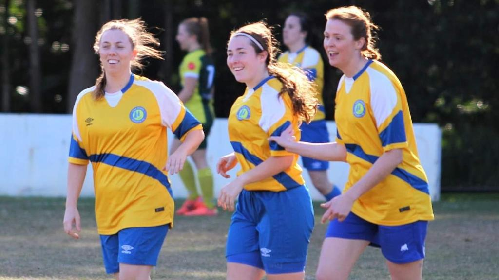 Pine Rivers Athletic Football Club women's team players Allison Banks, Amy Barter and Keir McEwan having a good time on the pitch.