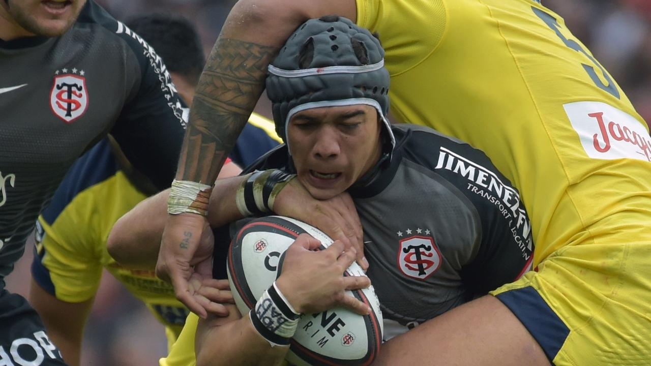Toulouse's South African winger Cheslin Kolbe is tackled at the Municipale Stadium.