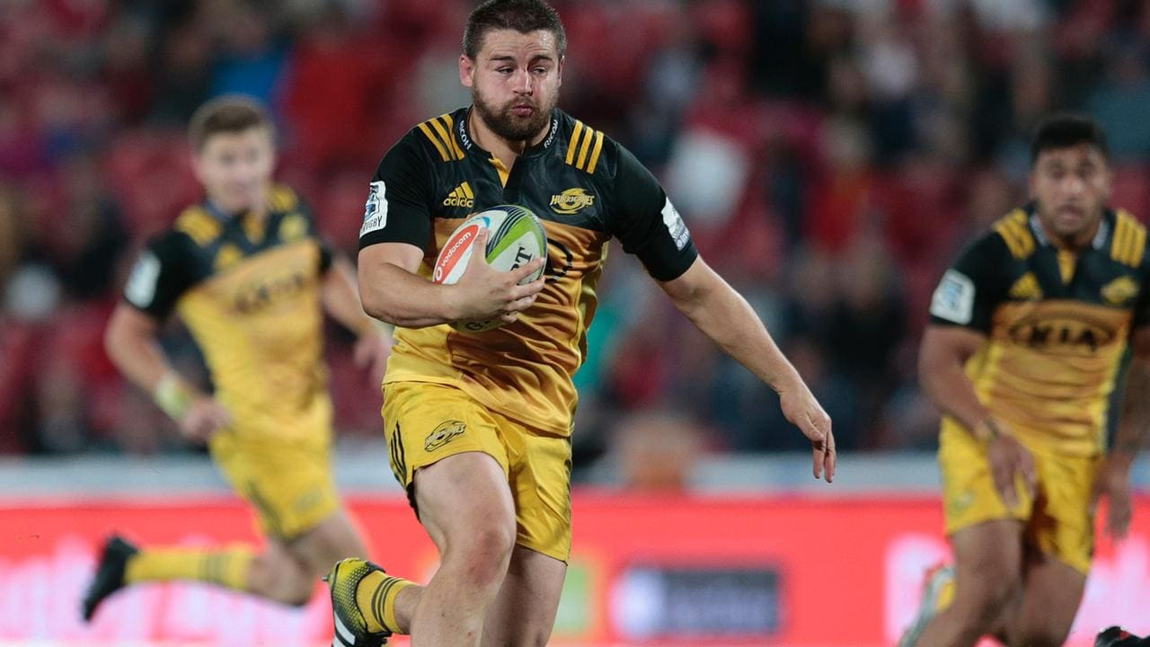 Hurricanes star Dane Coles makes a break at Ellis Park.