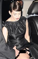 "Eeeek! Hollywood sweetheart Anne Hathaway showed more than she meant to when she hopped out of a car at the ""Les Miserables"" premiere...sans underwear. Picture: Splash News Australia"