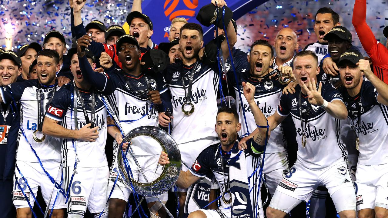 Melbourne Victory celebrate winning the 2018 A-League Grand Final.