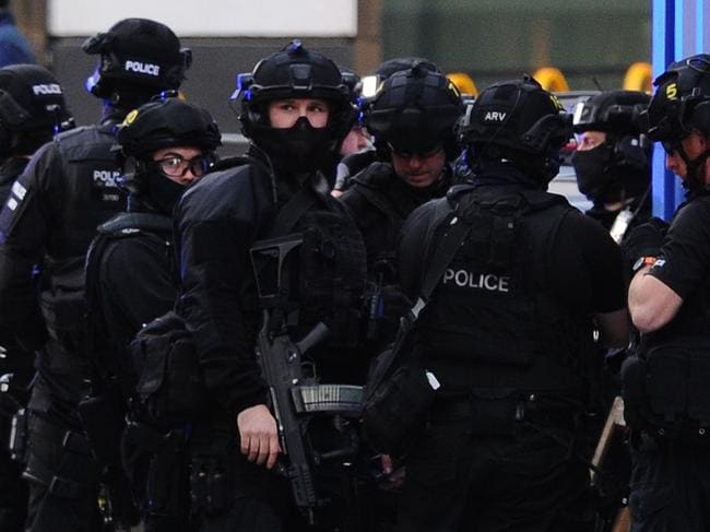 Police gather for a briefing at The Monument in London. Picture: DANIEL SORABJI / AFP.