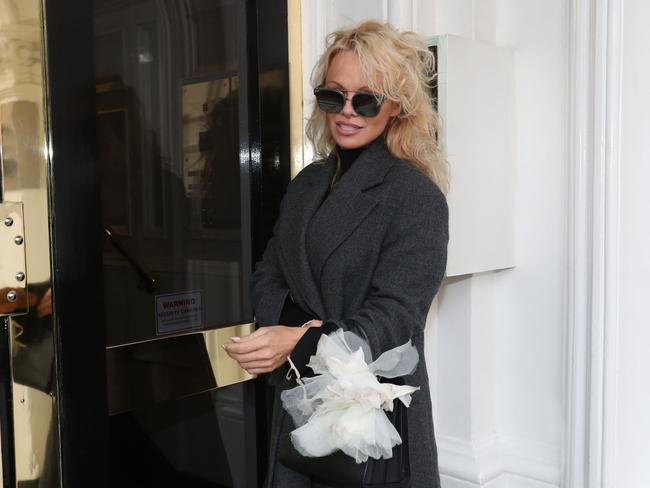 Pamela Anderson arrives to visit Julian Assange at the Ecuadorian embassy in London on Thursday February 23, 2017. Picture: Jonathan Brady/AAP