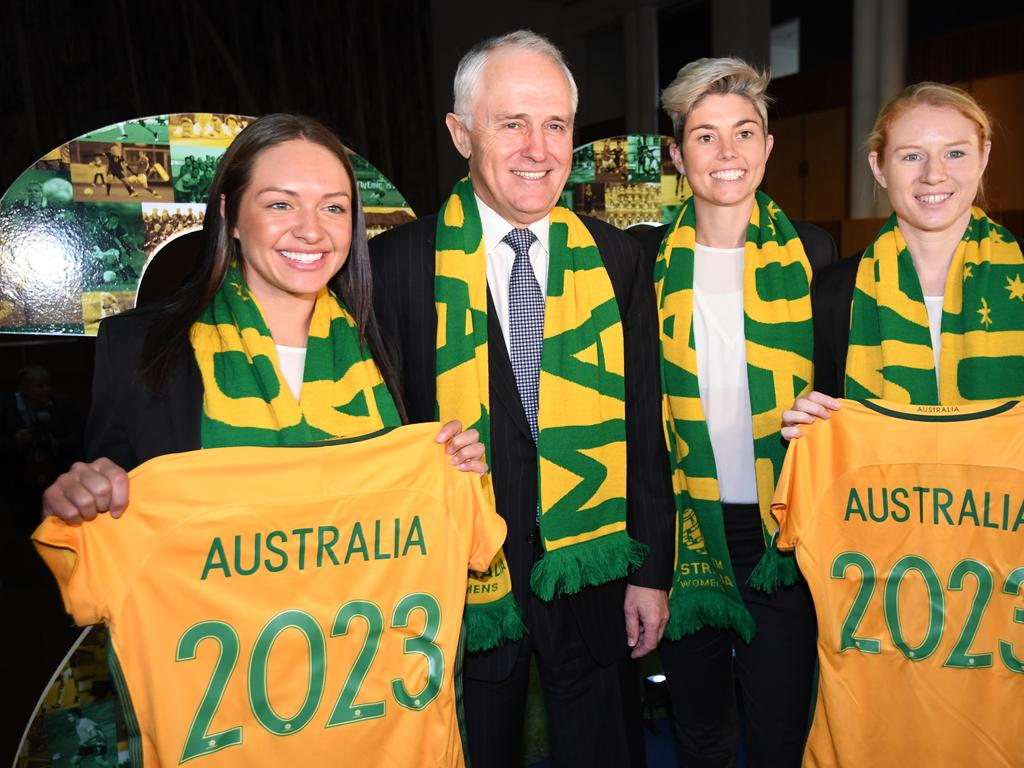 Australian Prime Minister Malcolm Turnbull poses for pictures with current Matildas Kyah Simon (left), Michelle Heyman and Clare Polkinghorne during an event supporting the FFA's bid to host the 2023 FIFA Women's World Cup at Parliament House in Canberra, Monday, June 13, 2017. (AAP Image/Lukas Coch) NO ARCHIVING