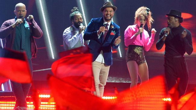 Bruno-esque ... Guy Sebastian, centre, performs Tonight Again at the Eurovision Song Contest in Vienna. Picture: AP Photo/Kerstin Joensson