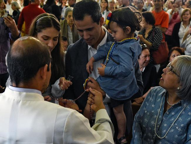 Venezuela's National Assembly head and self-proclaimed acting president Juan Guaido attends mass with his family on Sunday. Picture: Federico Parra/AFP