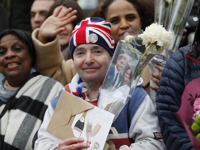 Royal fans await the arrival of Britain's Prince Harry and his fiancee Meghan Markle for their visit to the Reprezent 107.3 FM radio station in Brixton, south London. Picture: AP