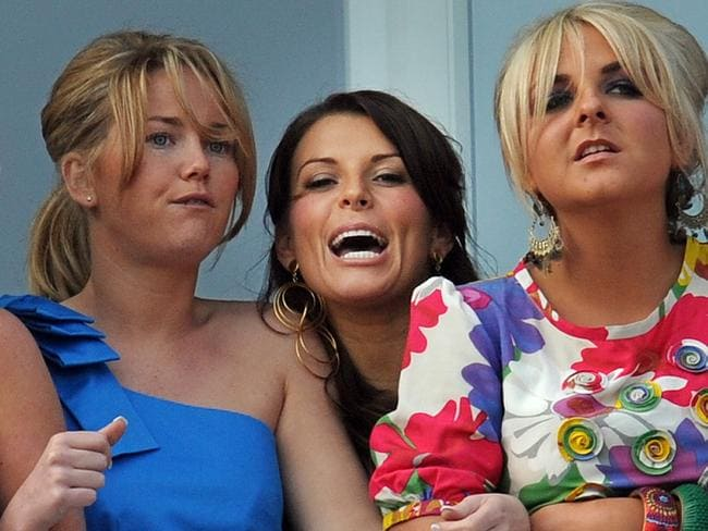 Coleen Rooney, centre, with friends at Aintree in 2009.
