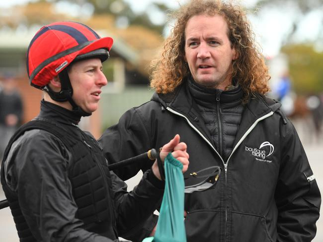 Damian Lane talks to trainer Ciaron Maher after riding Humidor in a recent trial.