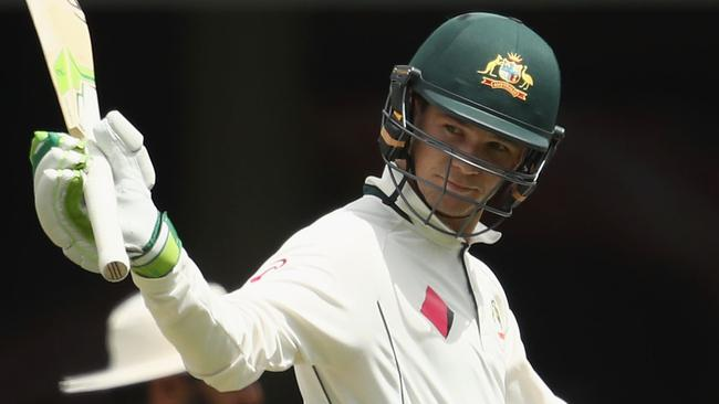 Peter Handscomb of Australia celebrates an historic half-century at the SCG.
