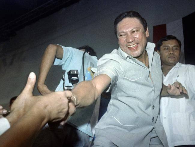 This file photo taken on February 12, 1988 shows shows General Manuel Antonio Noriega reaching to shake the hands of followers who attended his birthday party held by government officials and party workers in Pananma Citry, Panama. Picture: AFP / CARLOS SCHIEBECK