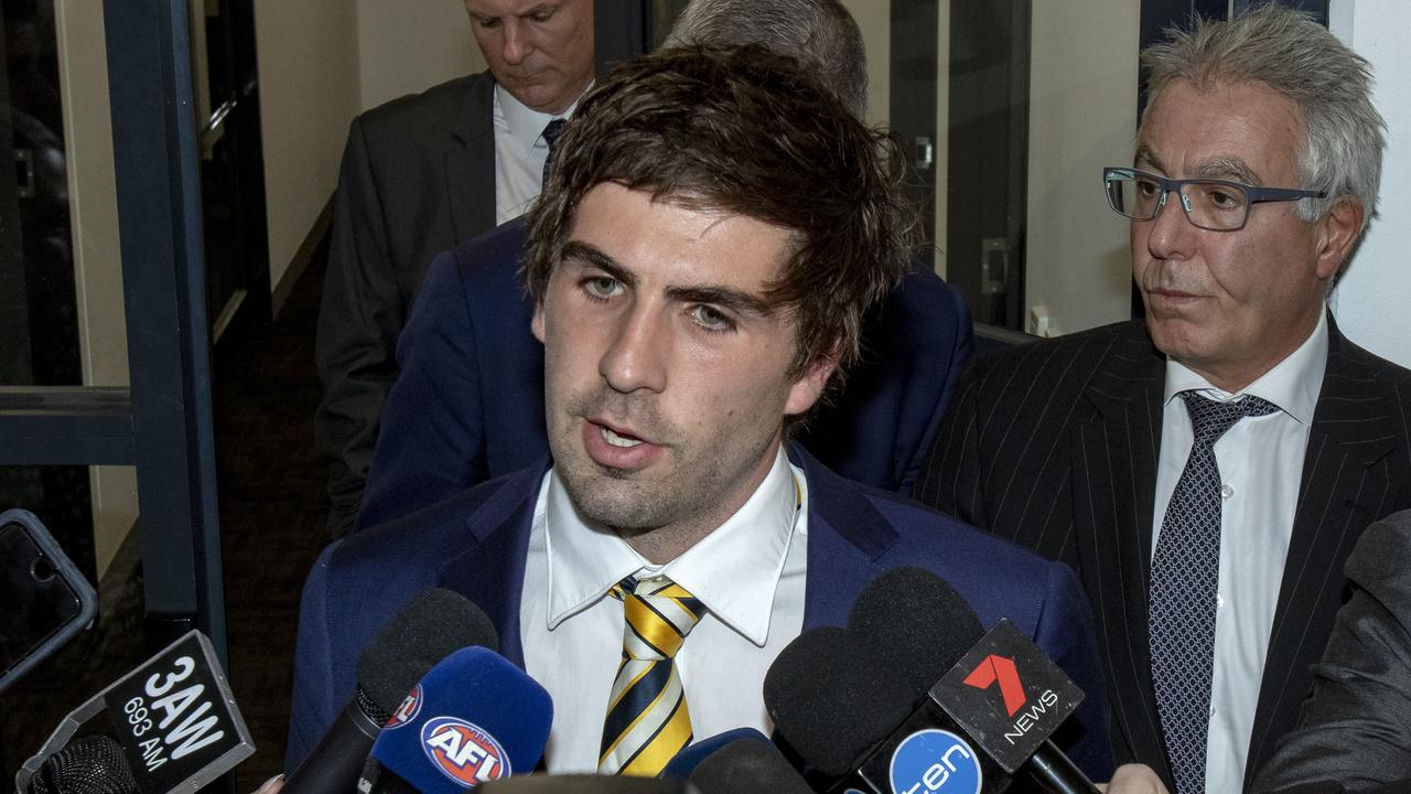 West Coast Eagles midfielder Andrew Gaff with David Grace QC in the background.